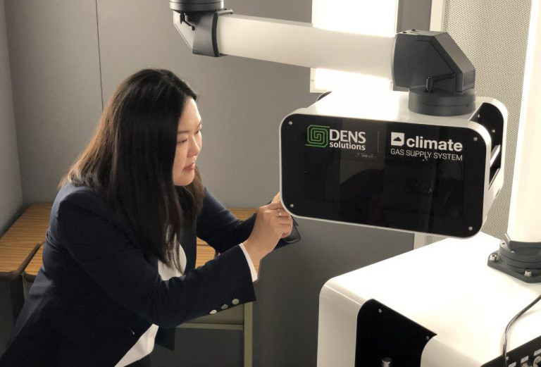 Yuanyuan Zhu, director of the InToEM center, works with the DENSsolutions Climate system at UConn Tech Park. (UConn Photo)
