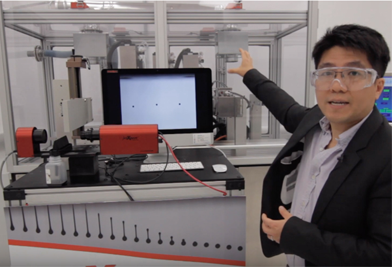 "Chemical Engineering Professor Anson Ma explains the ""drop watcher system"" on HuskyJet, which gives the user the ability to test and measure the droplet volume, velocity, and trajectory of any new ink or substance to achieve optimal printing performance."
