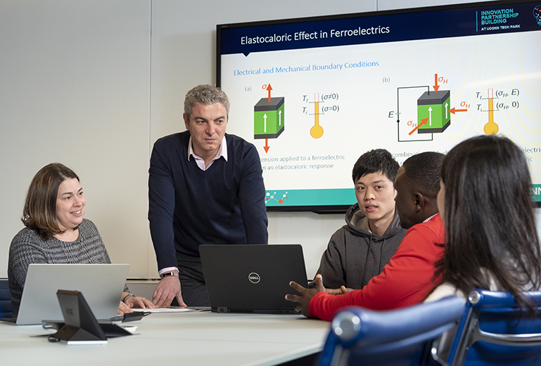 (left to right) Amy Thompson, George Bollas, Xi Yang,David Tamim Manan, and Chen Chen in a presentation room at the IPB (Innovation Partnership Building) on Feb. 5, 2019. (Al Ferreira/UConn Photo)