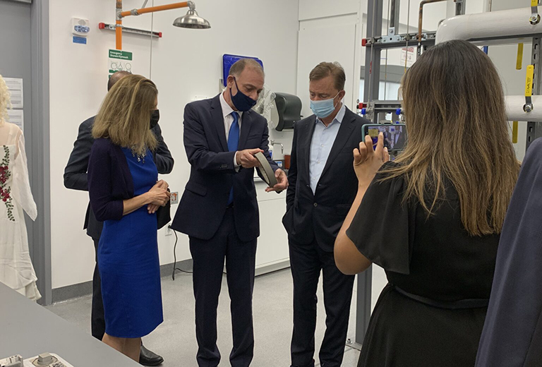 photo of Governor Ned Lamont and Lt. Governor Susan Bysiewicz talk with Associate Dean and Executive Director of the UConn Tech Park Pamir Alpay in the Pratt and Whitney Additive Manufacturing Center. (UConn Photo/Eli Freund)